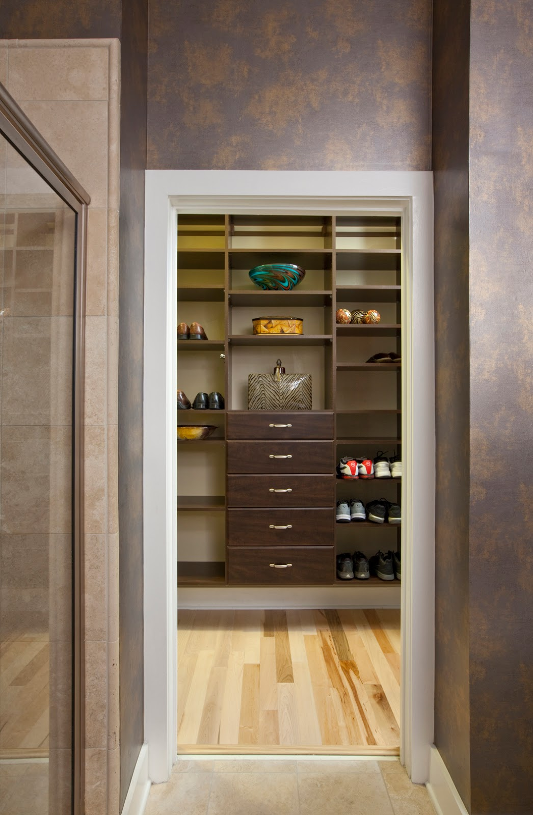 Dark wood custom closet designed by Robin LaMonte of Rooms Revamped Interior Design