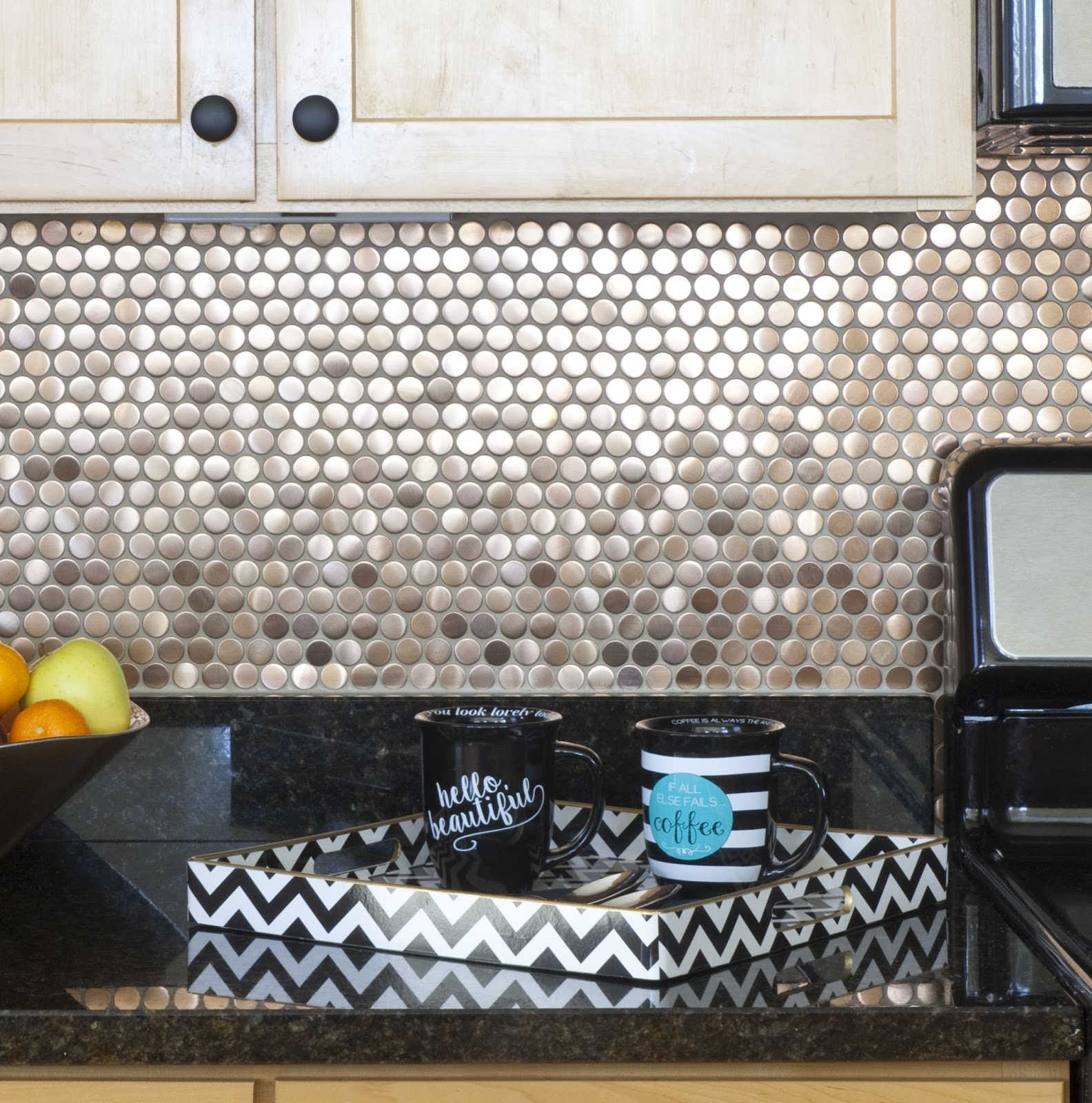 Copper penny tile backsplash designed by Robin LaMonte of Rooms Revamped Interior Design