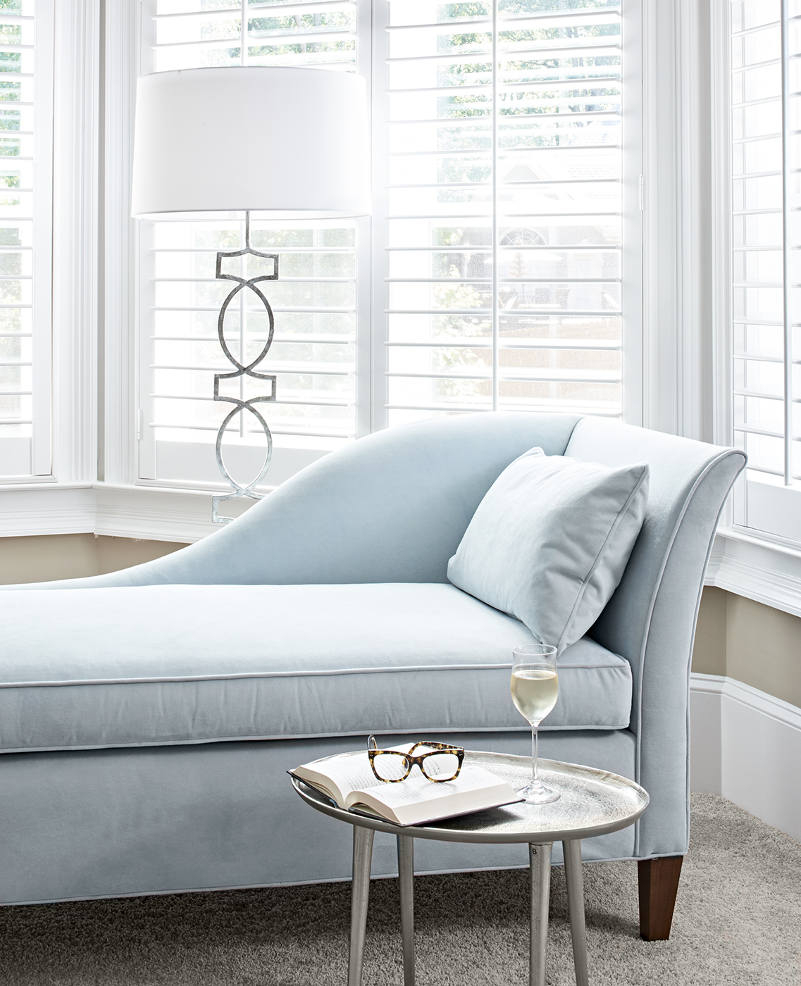 Soft blue chaise perfect for reading and a glass of wine