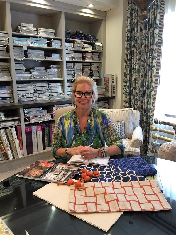 Robin LaMonte is working on a design project using complementary colored fabrics